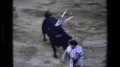 1972: bull is running after men with red rag MAZATLAN MEXICO Stock Footage