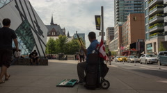 Time lapse street musician Stock Footage