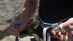 Rock climbing detail of a belay device. Stock Footage