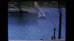1972: people playing and swimming in a massive outdoor swimming pool MAZATLAN Stock Footage