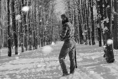 Monochrome landscape man with axe Stock Photos