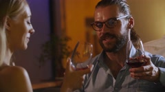 Young beautifil couples sitting in a bar and drink wine and cocktails, They have Stock Footage