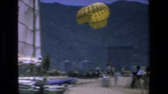 1972: people gathered around to watch a skydiver. MAZATLAN MEXICO Stock Footage