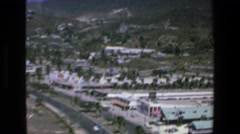 1972: view of highway buildings alongside fast moving lanes MAZATLAN MEXICO Stock Footage