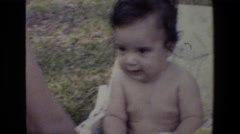 1982: baby spending the day outside not having a care in the world. SAN ANTONIO Stock Footage