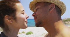 4K Close up of happy loving couple sharing a kiss at the beach Stock Footage
