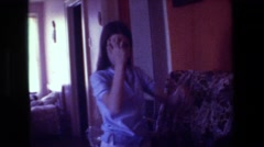 1981: one older girl and one baby girl inside a house on the sofa HOLLYWOOD Stock Footage