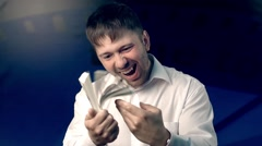 Portrait of happy man holding and playing with a huge bundle of money Stock Footage