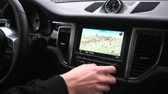 Man uses a gps navigator in the car Stock Footage