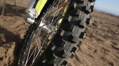 Moto type wheel marco on beach 50 p Stock Footage