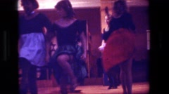 1981: girls in period costumes do a line dance on a stage for an audience Stock Footage