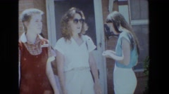 1981: three beautiful young girls standing in front of a buildings LANSING Stock Footage