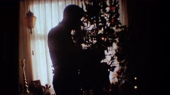 1981: person opening a present LANSING MICHIGAN Stock Footage