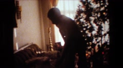 1981: man admiring his new christmas present LANSING MICHIGAN Stock Footage