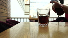 Pouring cola from the bottle into a glass Stock Footage