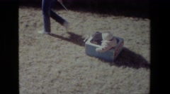 1981: girl carrying baby pulling grass cars parked moving around sunny weather Stock Footage