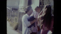 1981: grandma teaches baby to wave goodbye while mom watches LANSING MICHIGAN Stock Footage