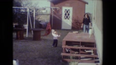 1981: mother and child backyard having fun LANSING MICHIGAN Stock Footage