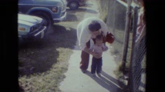 1981: little girl walking around tree LANSING MICHIGAN Stock Footage