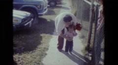1981: little girl walking around tree LANSING MICHIGAN Stock Footage