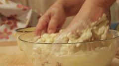 Woman knead the dough by hand Stock Footage