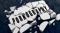 "Word block with ""Pornography"" written on it falls to the ground and breaks. Stock Footage"