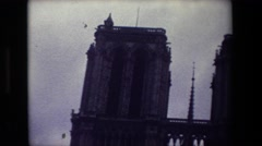 1981: two-pillared gothic cathedral on a gloomy day PARIS FRANCE Stock Footage