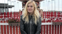 Portrait Girl Near the Red Carousel on the Street Stock Footage