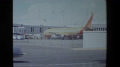 1981: large colorful airplane moving back in the aerodrome SAN DIEGO NAVAL BASE Stock Footage