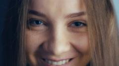 EXTREME CLOSE UP shot of young female eyes blinking Stock Footage