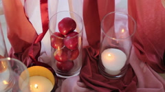 Wedding decor of apples and candles Stock Footage