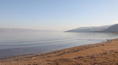 Sea of Galilee with the mountains of Jordan on the horizon, Israel Stock Footage