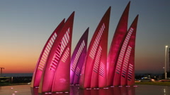 Sculptural group sail with changing colors at sunset in Ashdod Stock Footage