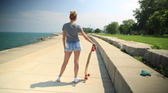 A young woman with her longboard skateboard. Stock Footage