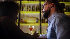 Hipster man to make the acquaintance of black sexy girl at the bar. They drink Stock Footage