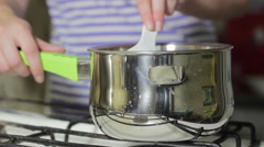 Cook stirs the food in the pan Stock Footage
