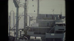 1981: ship sailing on the ocean and flags flying high. SAN DIEGO NAVAL BASE Stock Footage