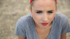 Portrait of a young woman with a red bandana. Stock Footage
