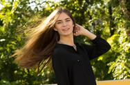 Young woman touching her hair Stock Photos