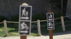 Trail signs for hiking and mountain biking at a resort, slow motion. Stock Footage