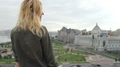 Woman Sitting on the Viewing Platform Overlooking the City of Kazan Stock Footage