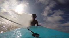 A boy wears goggles while going body boarding at the beach. Stock Footage