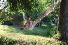 Kid in hammock on nature Stock Photos