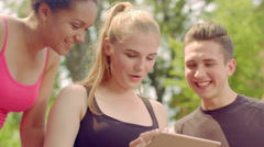 Young people having fun together with tablet computer. Happy friends smiling Stock Footage