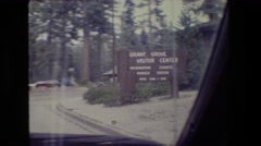 1984: tourists driving by grant grove visitor center and seeing tall trees. Stock Footage