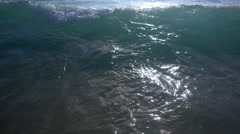 The whitewash of waves breaking in the surf at the beach, super slow motion. Stock Footage