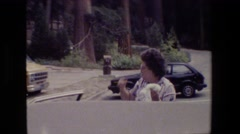 1984: woman grabbing something out of vehicle at a national park  Stock Footage