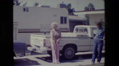 1984: family standing by the vehicles socializing. CALIFORNIA Stock Footage