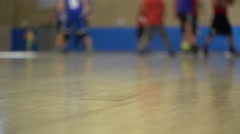 Boys playing basketball in an indoor gym. Stock Footage