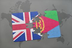 Puzzle with the national flag of great britain and eritrea on a world map bac Stock Photos